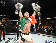 NEW YORK, NY - NOVEMBER 12:  UFC lightweight and featherweight champion Conor McGregor of Ireland celebrates after defeating Eddie Alvarez in their UFC lightweight championship fight during the UFC 205 event at Madison Square Garden on November 12, 2016 in New York City. (Photo by Jeff Bottari/Zuffa LLC/Zuffa LLC via Getty Images)