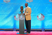 Aug 3, 2019; Canton, OH, USA; Ty Law poses with bust during the Pro Football Hall of Fame Enshrinement at Tom Benson Hall of Fame Stadium. (Robin Alam/Image of Sport)