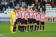 CTFC squad during the 2 min silence during the The FA Cup match between Hartlepool United and Cheltenham Town at Victoria Park, Hartlepool, England on 7 November 2015. Photo by Antony Thompson.