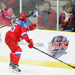 COBOURG, - Dec 19, 2015 -  Gold Metal Game - Russia vs Canada West at the 2015 World Junior A Challenge at the Cobourg Community Centre, ON. Viacheslav Shevchenko #35 of Team Russia tries to knock down the puck in the air during the second period.(Photo: Tim Bates / OJHL Images)