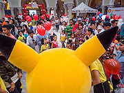 10 JANUARY 2015 - BANGKOK, THAILAND: People walk past the Pokemon character at Children's Day festivities in Bangkok. National Children's Day falls on the second Saturday of the year. Thai government agencies sponsor child friendly events and the military usually opens army bases to children, who come to play on tanks and artillery pieces. This year Thai Prime Minister General Prayuth Chan-ocha, hosted several events at Government House, the Prime Minister's office.    PHOTO BY JACK KURTZ