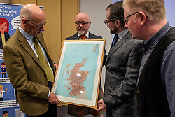 Pictured: Johns Swinney, Stewart Bermner, who ehlep develop the digital map with  Dr Davvit Horsbroch (extreme right) and Dr Michael Dempster, Director of the Scots Language Centre<br />
