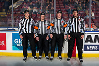 KELOWNA, CANADA - MARCH 9:  Lineman Dustin Minty, Referee Ryan Benbow, Referee Brett Iverson and Lineman Nathan VanOosten stand on the ice at the start of the game between Kelowna Rockets and Kamloops Blazers on March 9, 2019 at Prospera Place in Kelowna, British Columbia, Canada.  (Photo by Marissa Baecker/Shoot the Breeze)