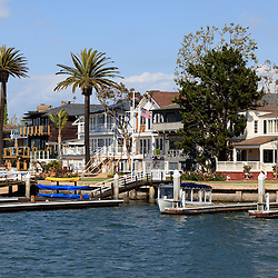 Photo of waterfront luxury homes in Newport Beach in Orange County California. Newport Beach is a wealthy beach community along the Pacific Ocean in Southern California. Photo is high resolution and was taken in 2012.