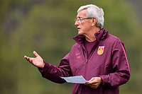 Head coach Marcello Lippi of the Chinese national men's football team takes part in a training session before the semi-final match against Wales during the 2018 Gree China Cup International Football Championship in Nanning city, south China's Guangxi Zhuang Autonomous Region, 19 March 2018.
