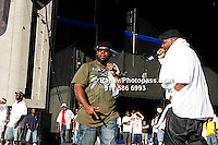Ghostface (white shirt and towel) and Raekwon (khaki, green shirt, blue baseball cap and towel) at Nikon at Jones Beach Amphitheater for 'Rock The Bells' 2008 on August 3, 2008. . Rock The Bells