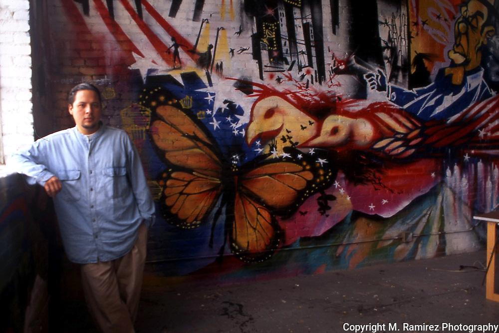 """""""Nuke"""" at his murals in his loft"""