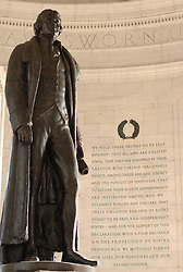 Interior of Jefferson Memorial in Washington DC with Jefferson on the Right and an inscription from the Declaration of Independence on the right