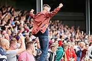 Scunthorpe fan celebrating after getting a late equaliser during the EFL Sky Bet League 1 match between Scunthorpe United and Rotherham United at Glanford Park, Scunthorpe, England on 12 May 2018. Picture by Nigel Cole.