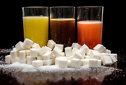 Embargoed to 2330 Wednesday November 21 File photo dated 15/12/17 of soft drinks surrounded by sugar cubes. A Canadian study has found sugar-sweetened drinks pose a greater risk of Type 2 diabetes than most foods containing naturally-occurring sugar fructose, like fruit. Meanwhile, research from the US has discovered shift work in combination with an unhealthy lifestyle poses a higher Type 2 diabetes risk than previously thought.