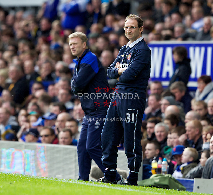 LIVERPOOL, ENGLAND - Saturday March 17, 2012: Sunderland's manager Martin O'Neill, with Everton's manager David Moyes in the background, during the FA Cup Quarter-Final match at Goodison Park. (Pic by Vegard Grott/Propaganda)