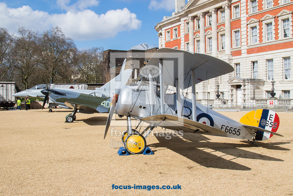 A 1918 Sopwith Snipe, a Spitfire Mk XVI and a Typhoon Eurofighter rest on the gravel as the Royal Air Force Museum promotes the forthcoming 100th anniversary of the Royal Air Force in 2018 with a static display of warplanes in Horseguards Parade, Westminster.<br /> Picture by Paul Davey/Focus Images Ltd +447966 016296<br /> 31/03/2016