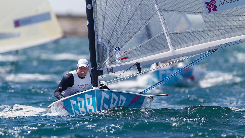 ENGLAND, Weymouth. 29th July 2012. Olympic Games. Finn class, Race 1. Ben Ainslie (GBR).