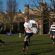 "Pupils practice rugby on the playing fields of Rugby School in central England, January 20, 2015.  The public school, founded in 1567 was amongst the first ""Public"" schools in England. The school is known as the home of rugby. Local legend  states that in 1823 pupil William Webb Ellis first ran with the ball inventing the game of rugby football which took its name from the school. In 2015 20 countries will compete in the Rugby World Cup which is hosted by England REUTERS/Neil Hall"