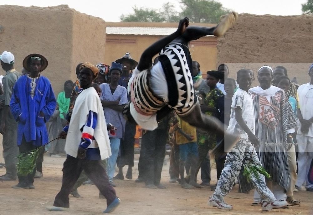 Young men compete for the best jump during the Festival des marionettes géantes de Diabolo. Djenné