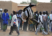Young men compete for the best jump during the Festival des marionettes géantes de Diabolo. Djenné