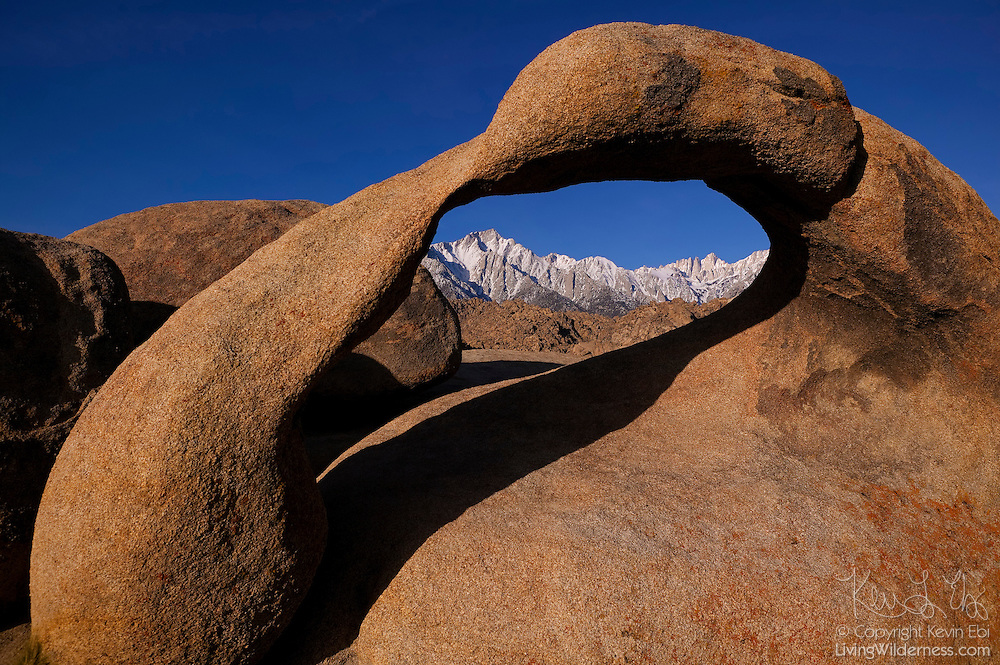 Mobius Arch, a natural granite arch in the Alabama Hills near Lone Pine, California, frames several high Sierra peaks, including Lone Pine and Mount Whitney. Mount Whitney is the highest mountain in the contiguous United States with an elevation of 14505 feet (4421 meters).