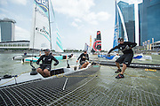 James Dagg, Dean Barker and Glenn Ashby. Emirates Team New Zealand practice for the first of the Extreme Sailing Series regattas being sailed in Singapore. 19/2/2014