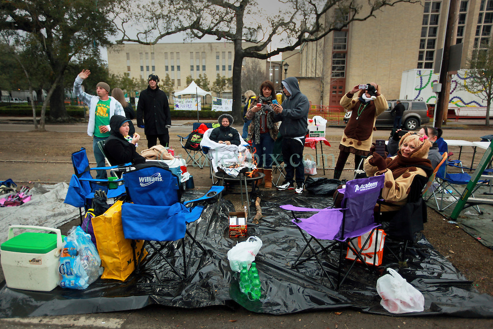 17 Feb 2015. New Orleans, Louisiana.<br /> Mardi Gras Day. Revelers warm up and prepare for Fat Tuesday in the early morning on St Charles Avenue before the big parades start to roll.<br /> Photo; Charlie Varley/varleypix.com