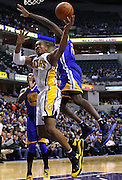 Feb. 28, 2012; Indianapolis, IN, USA; Indiana Pacers power forward David West (21) shoots the ball as Golden State Warriors power forward Ekpe Udoh (20) defends from over the top at Bankers Life Fieldhouse. Indiana defeated Golden State 102-78. Mandatory credit: Michael Hickey-US PRESSWIRE