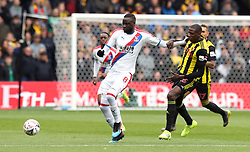 Crystal Palace's Cheikhou Kouyate (left) and Watford's Abdoulaye Doucoure battle for the ball during the FA Cup quarter final match at Vicarage Road, Watford.
