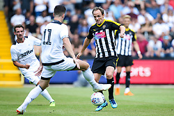 David Vaughn of Notts County takes on Tom Lawrence of Derby County - Mandatory by-line: Robbie Stephenson/JMP - 14/07/2018 - FOOTBALL - Meadow Lane - Nottingham, England - Notts County v Derby County - Pre-season friendly