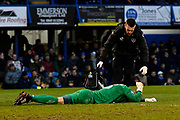 Stephen Henderson (13) of Portsmouth down with a painful leg injury which he had to leave the field for and was replaced by Kal Naismith (22) of Portsmouth during the EFL Sky Bet League 1 match between Portsmouth and Doncaster Rovers at Fratton Park, Portsmouth, England on 3 February 2018. Picture by Graham Hunt.