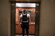 A Nigerian ThisDay Festival security guard is seen inside an an elevator in the lobby of the Abuja Hilton July 11, 2008 in Abuja, Nigeria. Pop stars Jay-Z, Rihanna and Usher joined local musicians and super models Naomi Campbell and Tyson Beckford at the Abuja leg of the festival, which is an annual event designed to raise awareness of African issues while promoting positive images of Africa using music, fashion and culture..