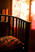Afternoon light falls on chair in hotel in Roatan, Honduras. Copyright 2010 Reid McNally.