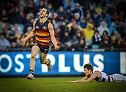 AFL.  Adelaide vs Geelong at AAMI Stadium.   Adelaide's Matthew Wright kicks the goal to take the lead in the final quarter avoiding the tackle of Geelong's Andrew Mackie