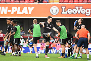Brentford players warm-up ahead of the EFL Sky Bet Championship match between Brentford and Queens Park Rangers at Griffin Park, London, England on 21 April 2018. Picture by Stephen Wright.