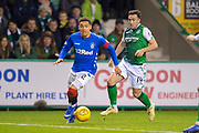 James Tavernier (#2) of Rangers FC sprints away from Stevie Mallan (#14) of Hibernian FC during the Ladbrokes Scottish Premiership match between Hibernian and Rangers at Easter Road, Edinburgh, Scotland on 19 December 2018.