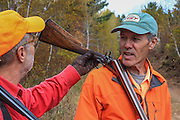 Hunters admire an old shotgun during a grouse hunt in Wisconsin