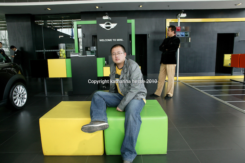 BEIJING, APRIL-22, 2010:  a customer waits for a sales assistant at the BMW/ Mini dealership .