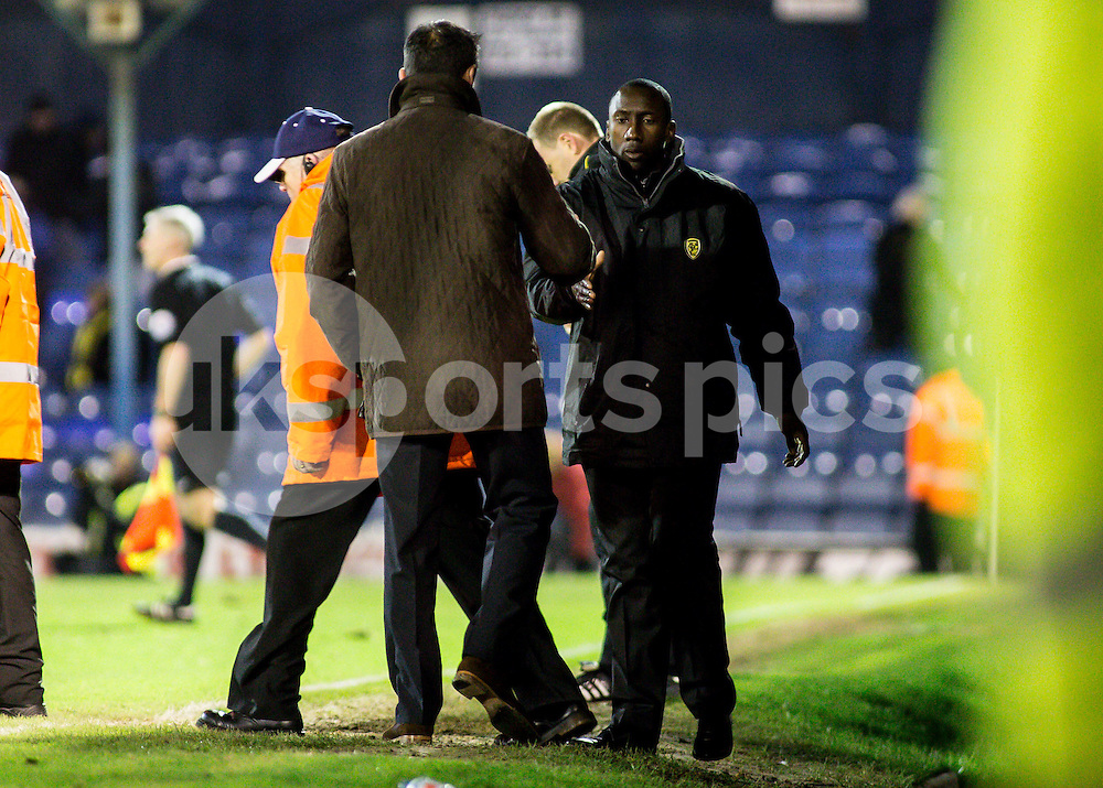 Burton Albion Manager Jimmy Floyd Hasselbaink  shakes hands with Southend Utd Manager Phil Brown after the final whistle during the Sky Bet League 2 match between Southend United and Burton Albion at Roots Hall, Southend, England on 19 December 2014. Photo by Liam McAvoy.