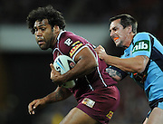May 25th 2011: Sam Thaiday of the Maroons is tackled by Mitchell Pearce of the Blues during game 1 of the 2011 State of Origin series at Suncorp Stadium in Brisbane, Australia on May 25, 2011. Photo by Matt Roberts/mattrIMAGES.com.au / QRL