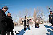 Kyrgyzstan: In the village of Jar-Bash, unemployed men have little to do. On a bright winter day they congregate in the street and drink vodka. January 2009