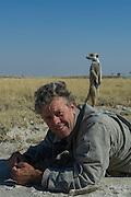 Meerkat or Suricate (Suricata suricatta) & Pete Oxford<br /> Makgadikgadi Pans, Kalahari Desert<br /> Northeast BOTSWANA<br /> HABITAT & RANGE: Kalahari Desert in Botswana, Namib Desert of Namibia, Angola and South Africa