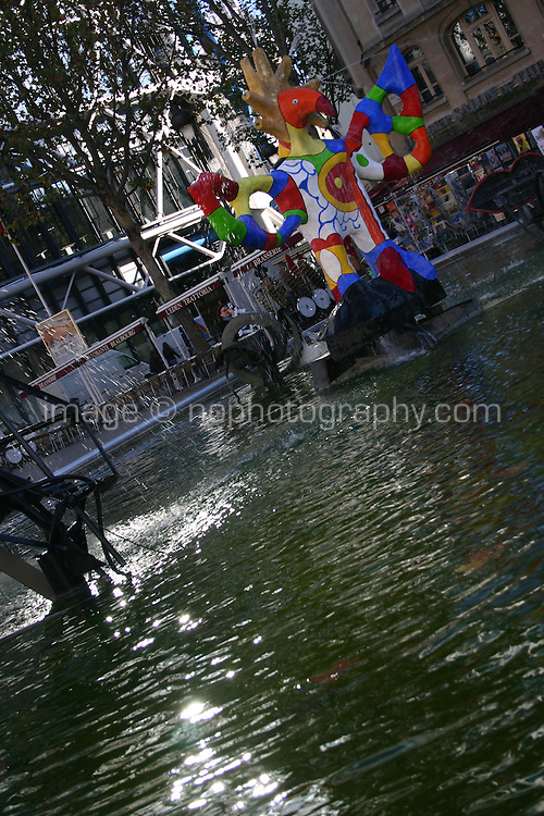 Fountaine Stravinsky, colourful moving sculptures and fountains by Jean Tinguely and Niki de St-Phalle in pool beside Place Igor<br />