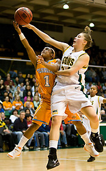 December 22, 2009; San Francisco, CA, USA;  Tennessee Lady Volunteers guard Briana Bass (1) shoots past San Francisco Dons guard/forward Ashley Boggs (24) during the second half at War Memorial Gym.  Tennessee defeated San Francisco 89-34.