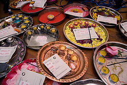 Flowers and divas on trays of offering in celebration of Navratri; the Hindu festival of Nine Nights,