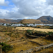 A view on the city of Yaiza, Lanzarote, with mountains in the background.
