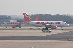 © licensed to London News Pictures. London, UK 23/03/2012. EasyJet airplanes preparing for take off at Gatwick Airport. Photo credit: Tolga Akmen/LNP