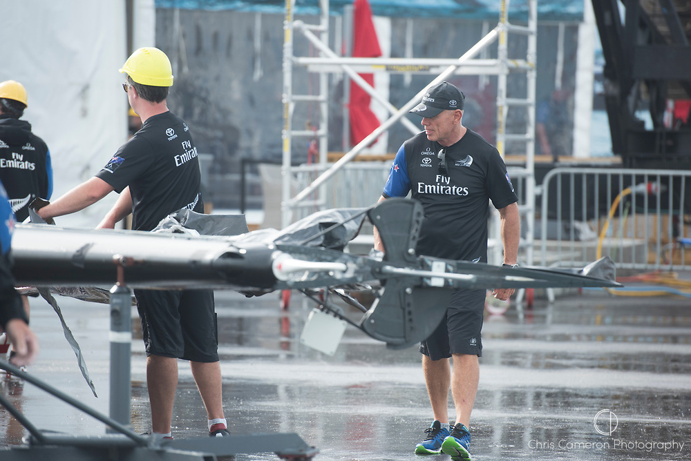 The Great Sound, Bermuda. 6th June 2017. Emirates Team New Zealand CEO Grant Dalton checks the wing damaged in the capsize during the pre start for their 4th Louis Vuitton America's Cup Challenger Playoff Semi-Final against Land Rover BAR (GBR).