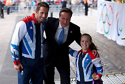 © Licensed to London News Pictures. 10/09/2012. LONDON, UK. The British Prime Minister, David Cameron, poses with gold medal winning athletes, sailor Ben Ainslie (L) and swimmer Ellie Simmonds as they arrive at a reception for British Paralympic and Olympic athletes held at the Queen Elizabeth II Conference Centre in London today (10/09/12). Photo credit: Matt Cetti-Roberts/LNP