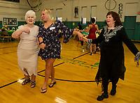 Virginia, Lexys and June tear up the dance floor during the Senior Senior dance Thursday evening at the Laconia Community Center.  (Karen Bobotas/for the Laconia Daily Sun)