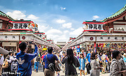 Nakamise Street teams with people shopping for sweets and souvenirs on the way to Senso-ji Temple - Akasusa, Tokyo - May 2015