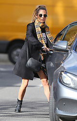 Love Island's presenter Caroline Flack wearing Ray-Ban sunglasses, Burberry scarf, black coat, Givenchy sweatshirt, denim shorts which shows off her perfect pins out and about in London, UK. 07/03/2019<br />