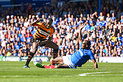 Andy Yiadom is tacked by Nigel Atangana during the Sky Bet League 2 match between Portsmouth and Barnet at Fratton Park, Portsmouth, England on 12 September 2015. Photo by David Charbit.