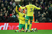 Norwich City midfielder Nelson Oliveira celebrates his hat trick goal with Norwich City defender Ivo Pinto and Norwich City defender Martin Olsson  during  the EFL Sky Bet Championship match between Norwich City and Derby County at Carrow Road, Norwich, England on 2 January 2017. Photo by Nigel Cole.
